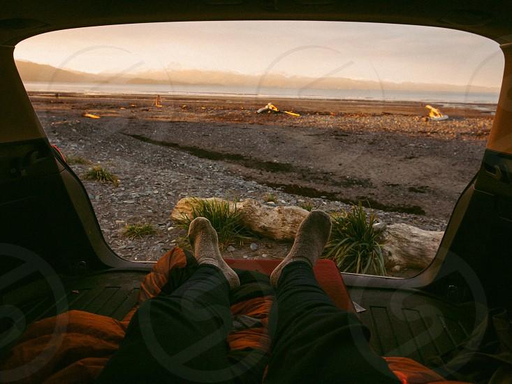 Ocean beach camping car camping travel Alaska sunrise  photo