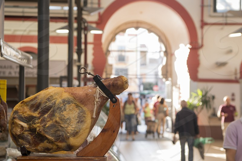 Ham in the Markethall in the town of Loule in the Algarve in the south of Portugal in Europe. photo