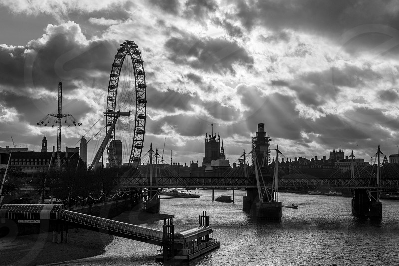 Sunlight breaking through the clouds on the river Thames near Westminster photo