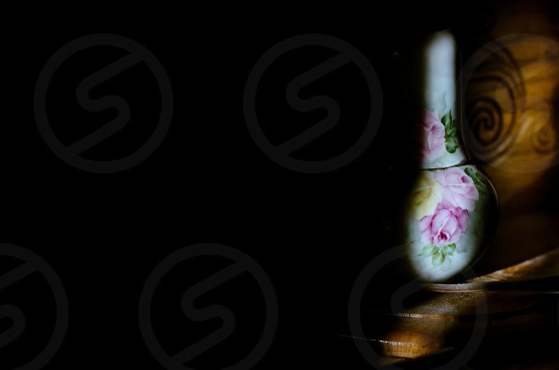 sunrise morning carafe cup indoor natural light sun negative space landscape vintage old flowers photo