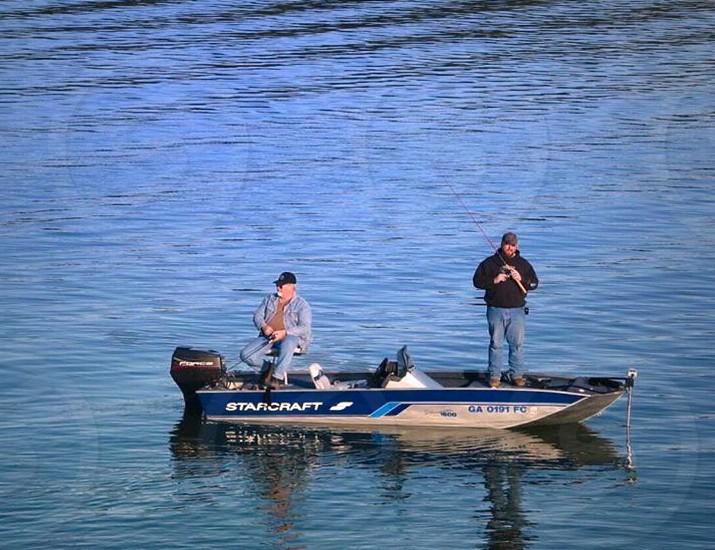 Editorial fishing fisherman boat fishing boat lake water blue sport photo