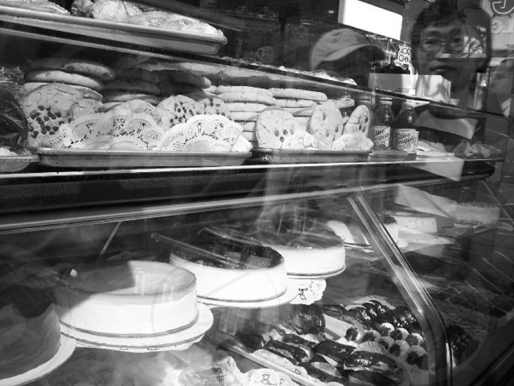 Reflection in bakery window photo
