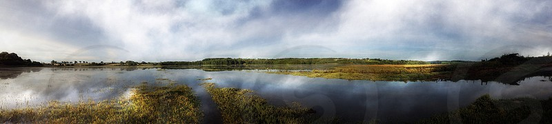 stratus clouds reflection on lake photography photo
