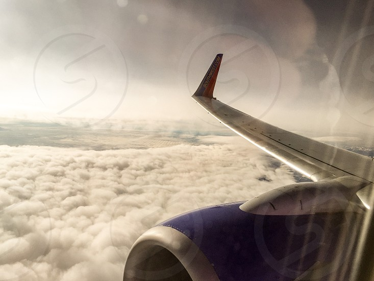 Plane airplane clouds travel wing photo