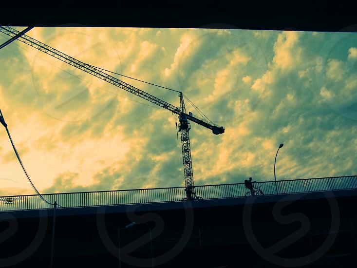 Two Bridges Biker Crane Sky Clouds Berlin photo