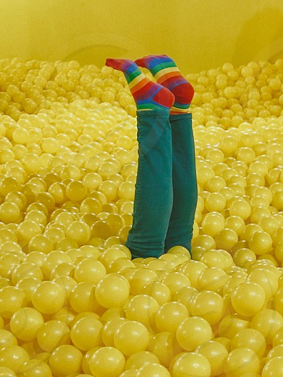 Rainbow sock yellow ball pit upside down photo