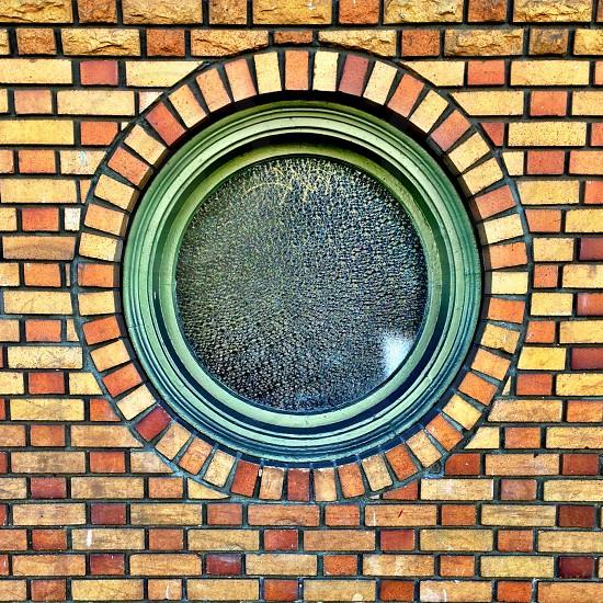 brown round brick framed window photo