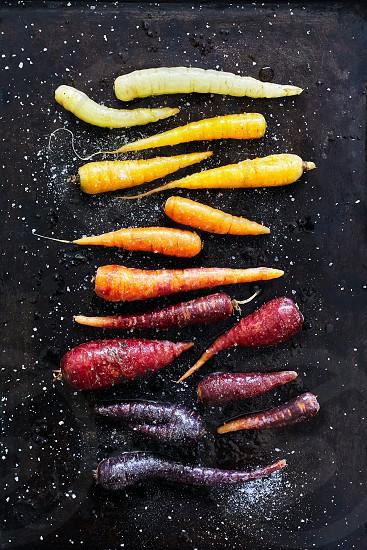 Rainbow heirloom carrots taken on baking sheet. photo