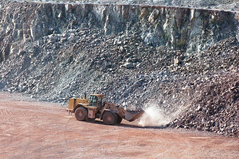 earthmover loading rocks in a quarry mine. photo