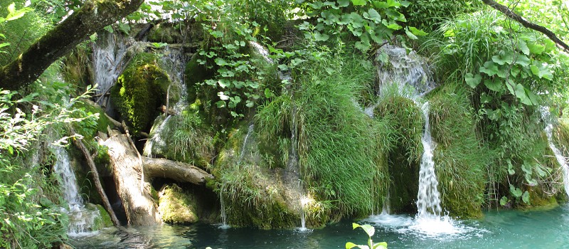 Waterfalls lush aqua pools trees vegetation splashing natural photo