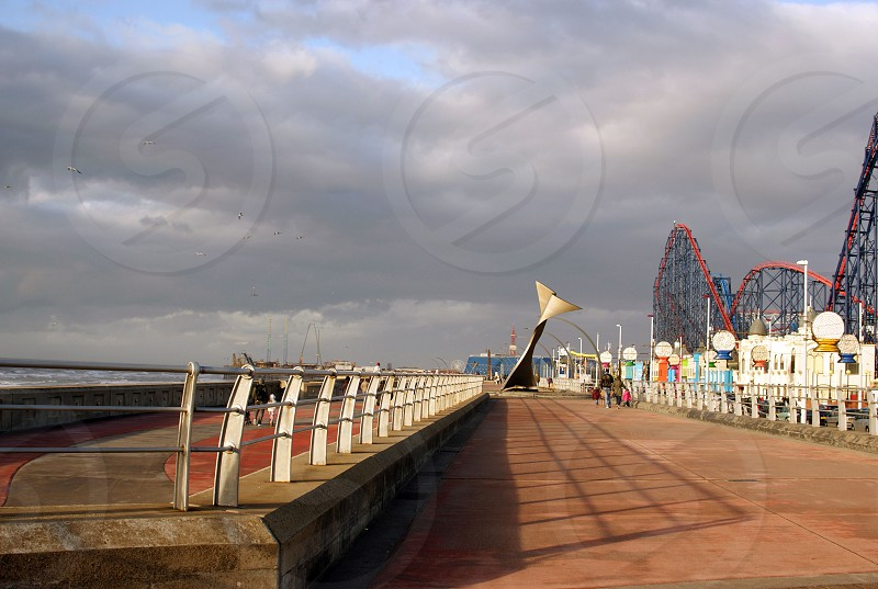 United Kingdom England. Blackpool looking along the Promenade with the Pleasure Beach on the right of frame  photo