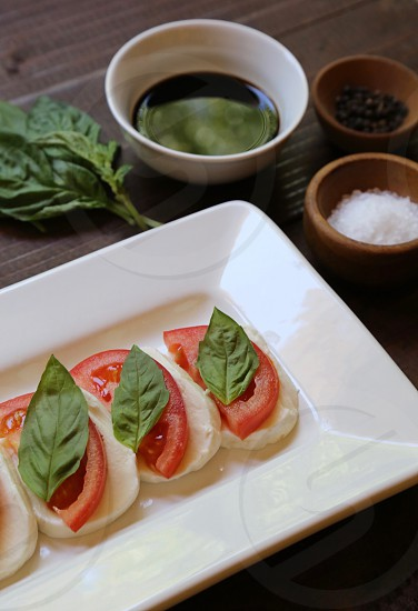 MozzarellaFresh Basil and Tomatoes photo