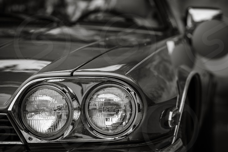Car headlights in black and white photo