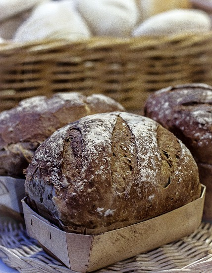 Freshly baked bread in a basket. photo