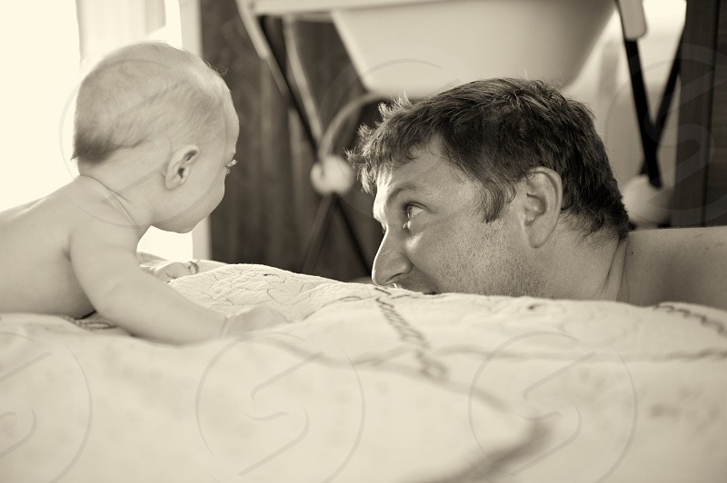 A boy playing with his father photo