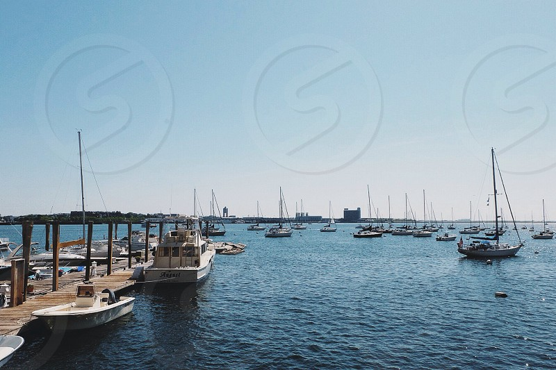 assorted boats on body of water under blue sky photo