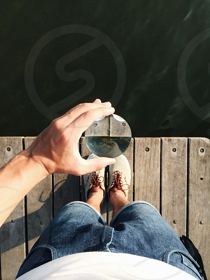 person holding a round magnifying glass photo