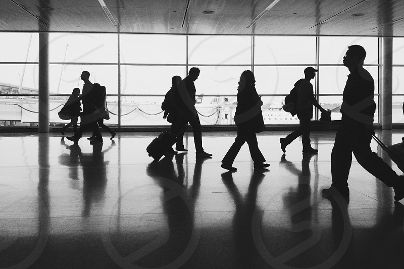 people silhouette at the airport grayscale photo