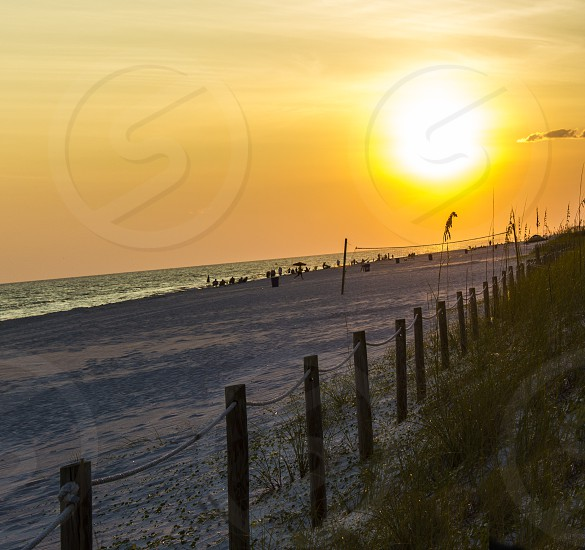 sunset beach summer sunshine orange sky ocean vacation fence fun relax relaxation serene night time dinner dinnertime photo