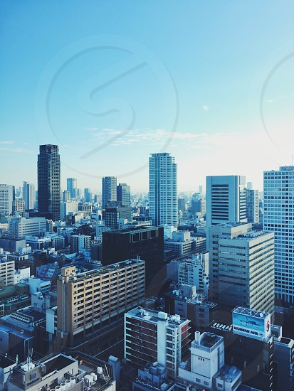 city Japan Osaka building buildings sky blue high tall perspective travel vacation downtown district clouds up high elevated drone photo