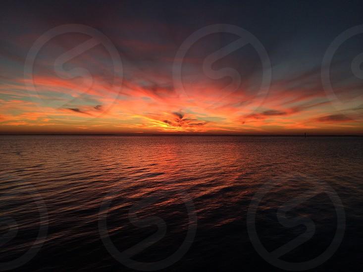 Sunset over Saint Joseph Bay photo