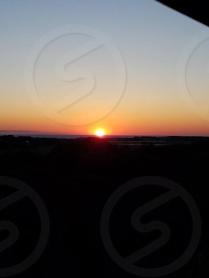 sunrise over the cape cod ocean photo