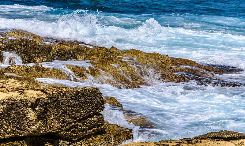 Rock under the waves photo