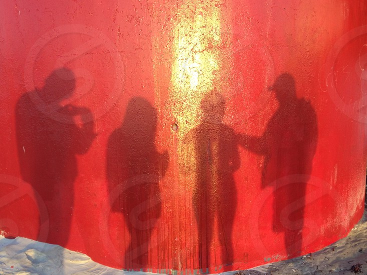 4 people shadows photo