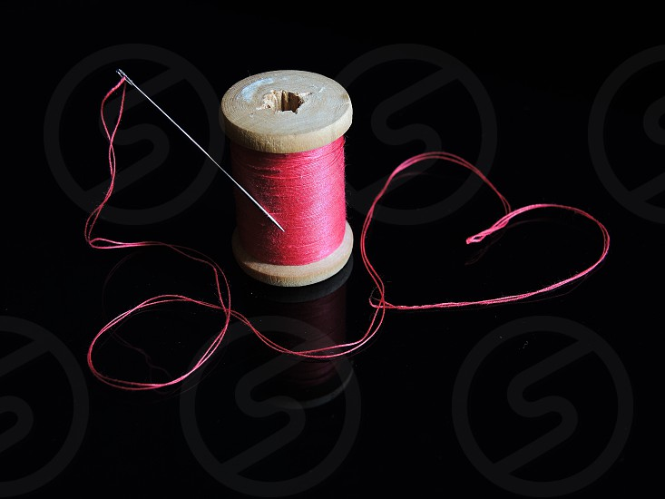 red yarn and needle photo
