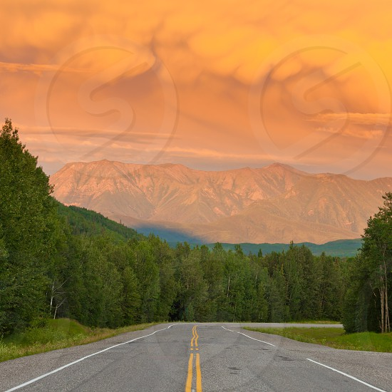 Liard River valley Alaska Highway  British Columbia  Canada  sunset light on approaching summer thunderstorm clouds photo