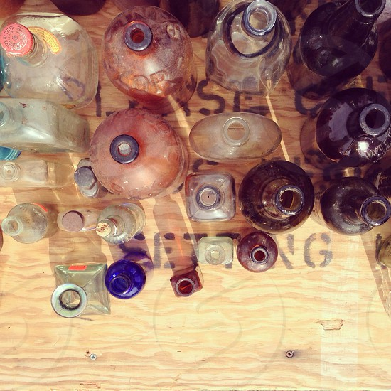 bottles on brown wooden surface photo