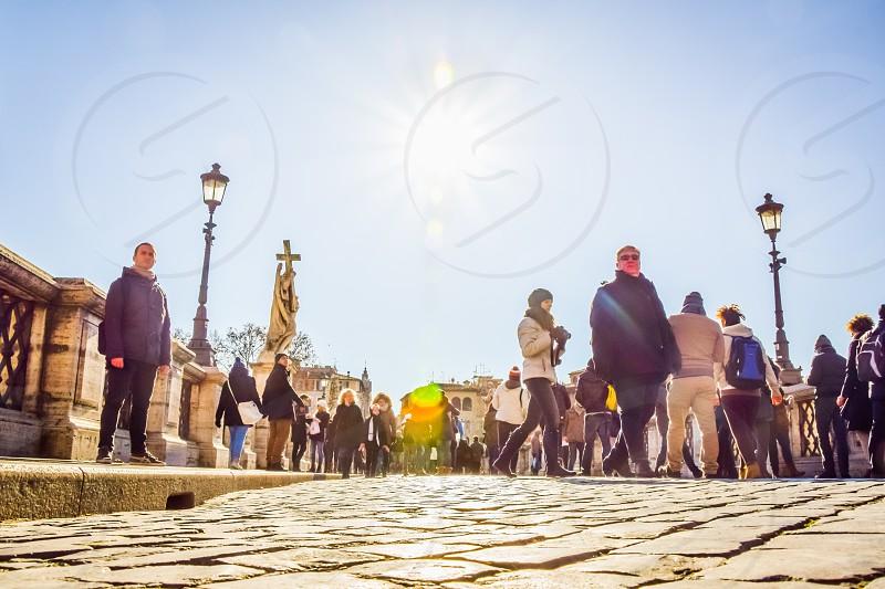 Crowd Of People Street Walking On Bridge Of Saint Angelo (Ponte Sant Angelo) In Rome Italy photo