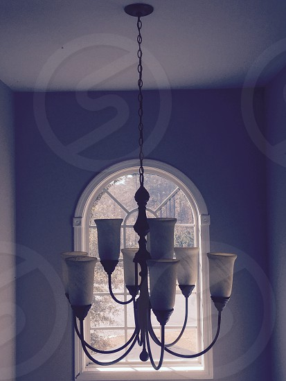 Lights and shadow on chandelier.   photo