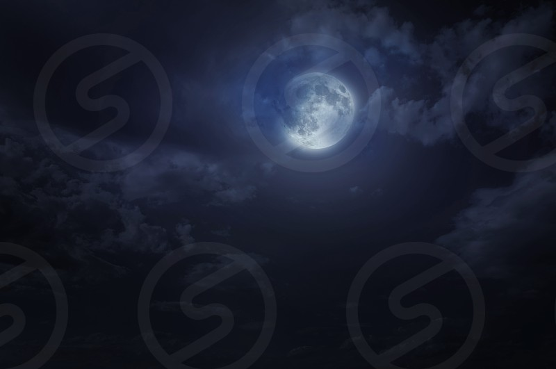 Night starry sky and moon. Night cloudy sky. Halloween background photo