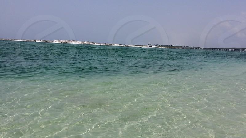 Clear beach water photo