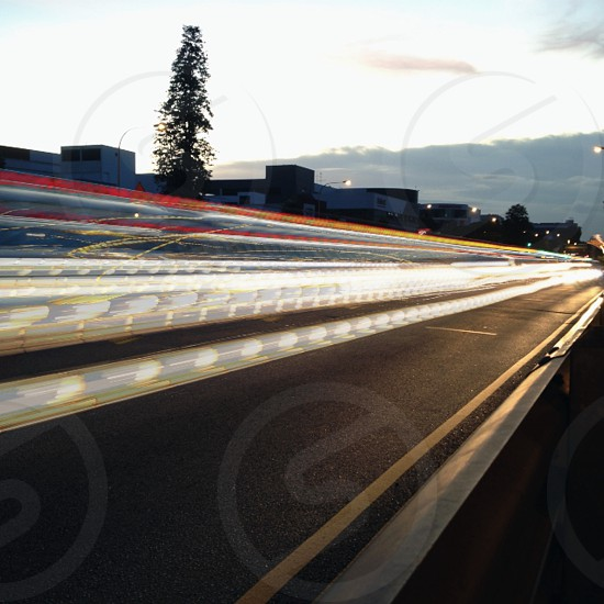 gray asphalt road with lights photo