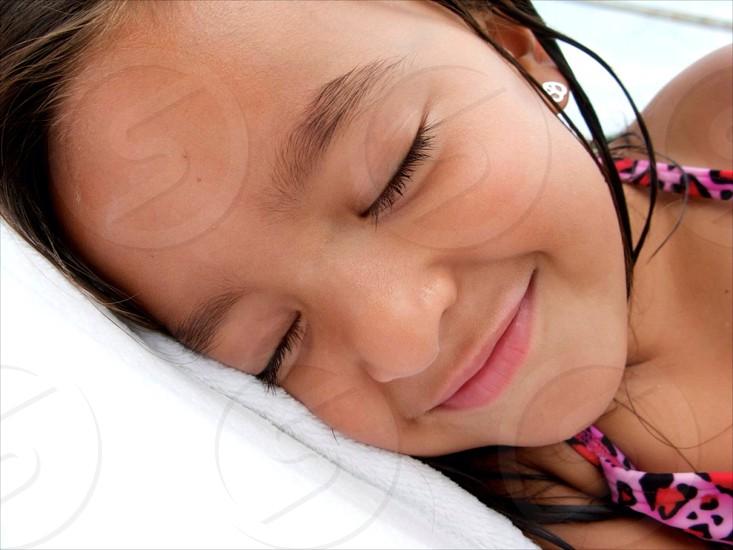 Little Amerasian girl smiling photo