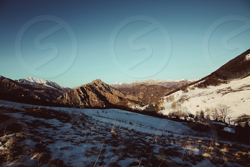 winter snow mountains grass landscape photo