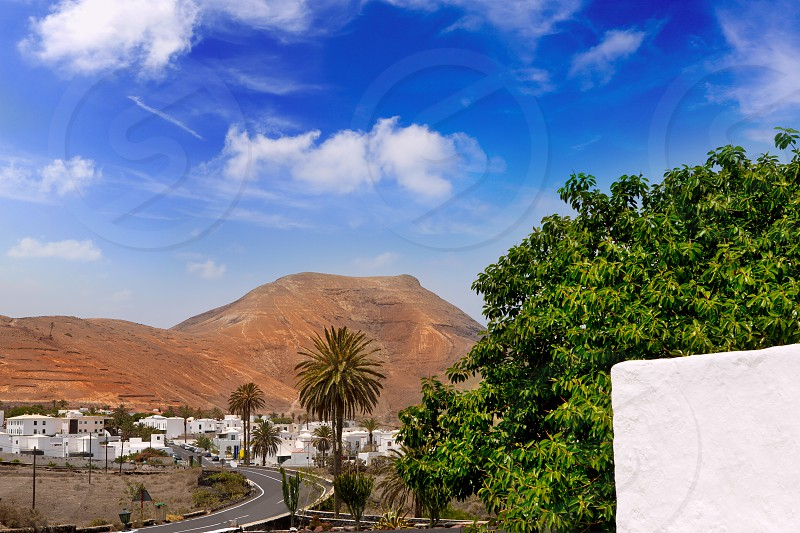 Lanzarote Yaiza white houses village under volcanic mountains of Canary Islands photo