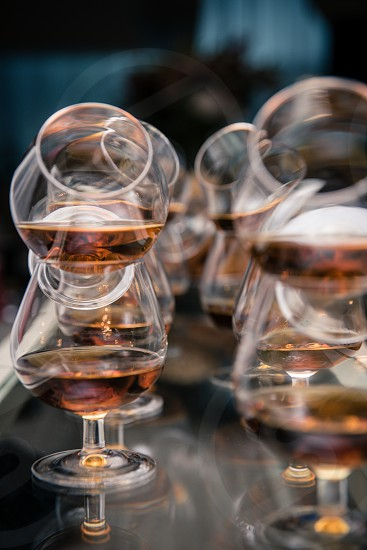 Whiskey glasses on the reflective table photo