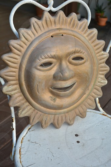 gold white sun medallion face anthropomorphic decoration rustic home decor crafts photo
