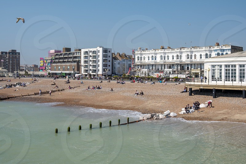 WORTHING WEST SUSSEX/UK - APRIL 20 : View of Worthing Beach in West Sussex on April 20 2018. Unidentified people photo