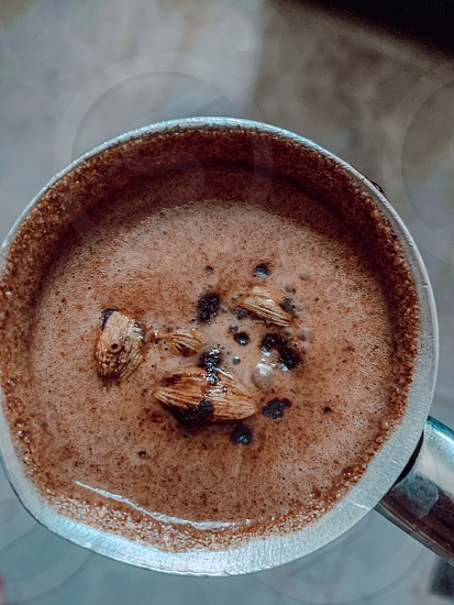 Cardamom coconut milk coffee coffee drink  photo