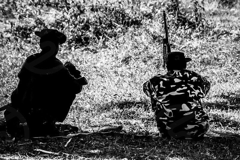 Two military personnel high in the mountains of the Chin State Myanmar. photo