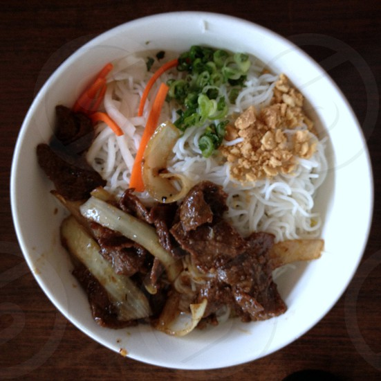 Thai beef bowl with vermicelli and vegetables photo