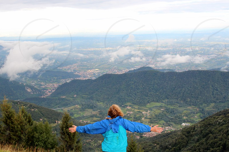 raised arms woman landscape Pian de le Femene top of the mountain photo