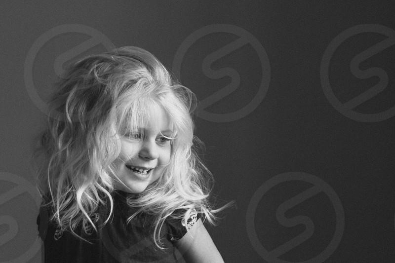 child portrait happy smile smiling blonde black & white black and white girl photo