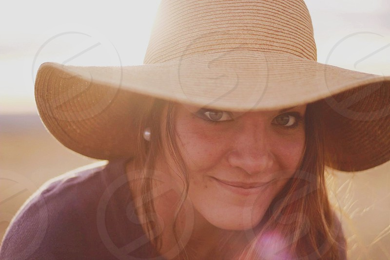 woman in brown straw hat photo