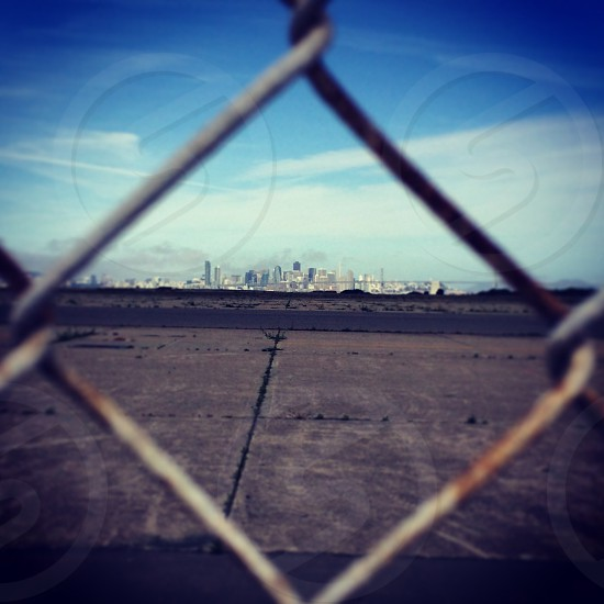 San Francisco through the fence. Takin from Alameda. photo