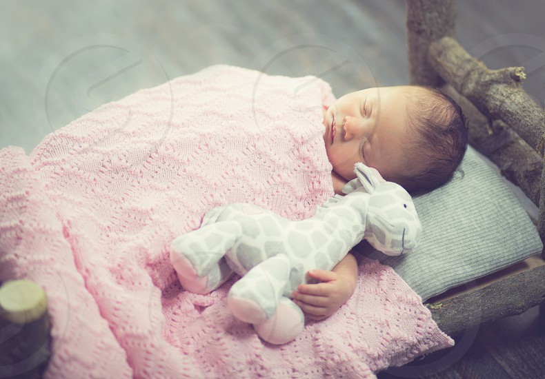 Newborn Baby on Wooden Bed photo